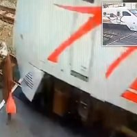 Woman walks across railway tracks second before train thunders past