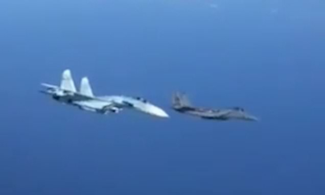 Astonishing moment Russian jet 'pushes' US F-15 by banking across it