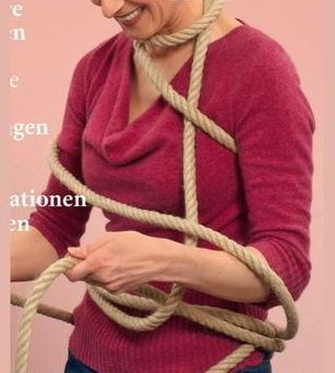 Bizarre cashmere jumper advert with model wrapped up in rope confuses eBay shoppers – with some joking it's 'secretly an ad for bondage'