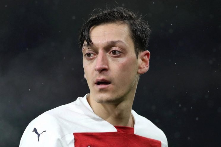 Arsenal fans convinced Ozil set for transfer window move after 'wave goodbye' as he was subbed against Cardiff