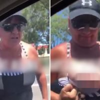 Bizarre moment woman flashes her BOOB at female driver in ridiculous road rage clash