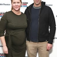 Mom-to-Be Amy Schumer Hits the Red Carpet — and Shows Off Her Bump — with Husband Chris Fischer