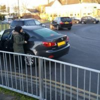 Frustrated school run mum parks her car in the middle of a ROUNDABOUT…and insists she CAN leave it there