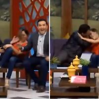 Disturbing moment pervy politician tries to force Mexico's answer to Susanna Reid to snog him live on air while she tries to fight him off