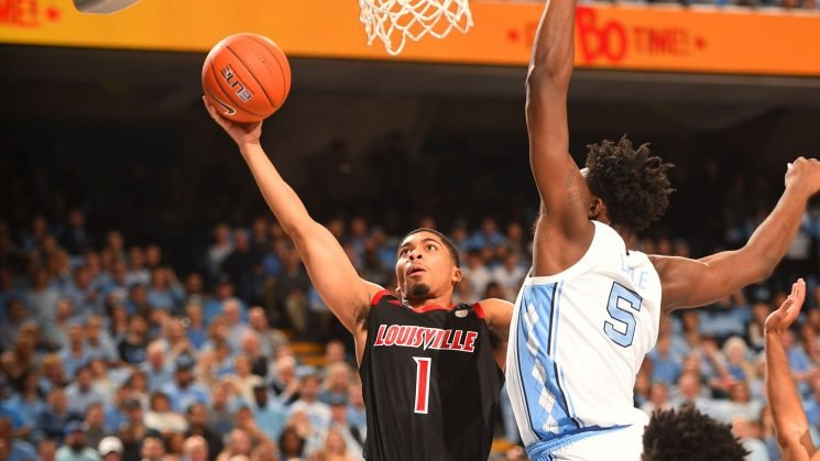 Louisville rolls from wire to wire, upsets No. 12 North Carolina in Chapel Hill