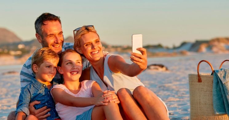 Brits more likely to choose to take their phone on holiday over family