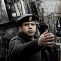 Officials say feud between train conductors led to Cairo crash, killing dozens