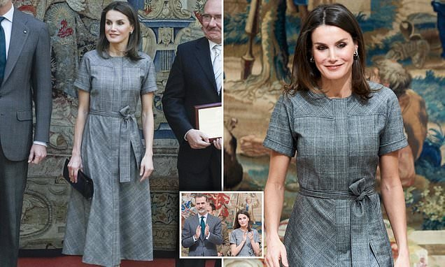 Queen Letizia looks smart in grey dress as she attends Spanish awards