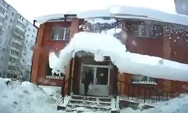 Man narrowly avoids being hit by a huge mass of snow
