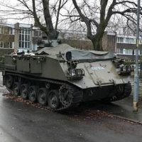 Motorist sparks outrage after he parks a military 'tank' on street