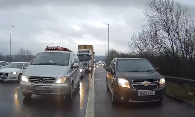 Car cruises down hard shoulder but drivers block them getting back on
