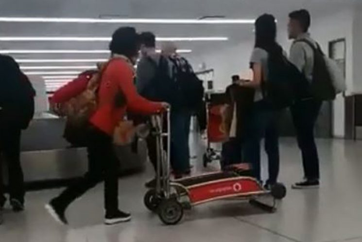Tourist struggles to push luggage trolley around airport – only to realise it's upside down in hilarious gaff