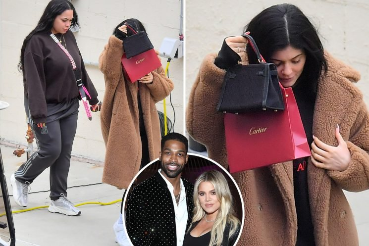 Kylie Jenner sheepishly covers her face as she steps out for first time since it was revealed BFF Jordyn Woods cheated with Tristan Thompson