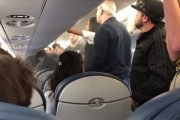 Shocked plane passengers watch as an overhead compartment starts burning after vape pen bursts into flames