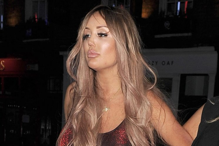 Charlotte Crosby needs help walking as she lets her hair down on boozy night out in London