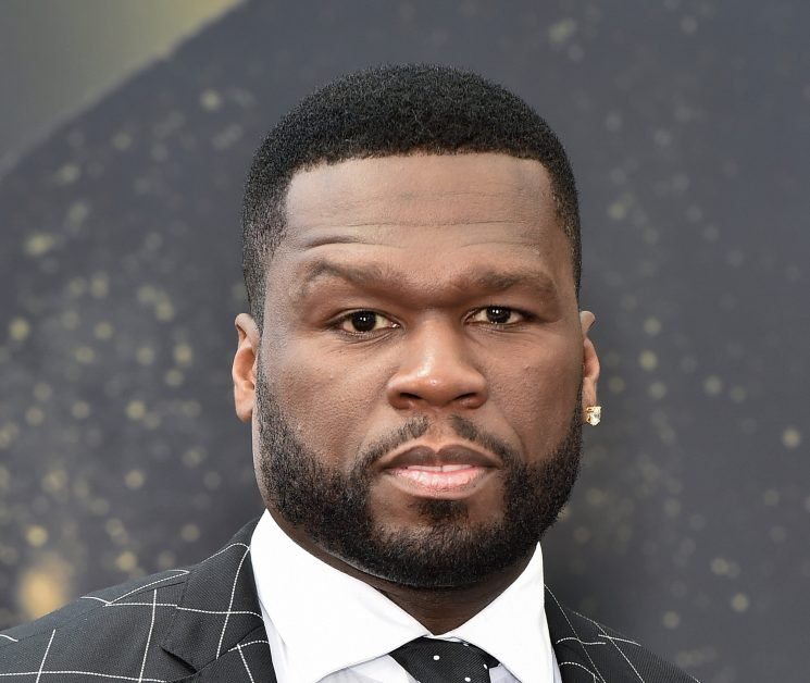 Cop under investigation for 'telling officers to SHOOT rapper 50 Cent on sight' amid Instagram feud