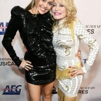 Miley Cyrus Honors Godmother Dolly Parton at MusiCares Party: 'The Most Non-Judgemental Person'