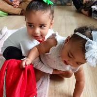Khloé Kardashian Shares Sweet Photos of True Hugging Cousin Dream amid Jordyn Woods Drama