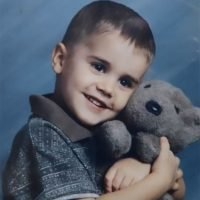 Hailey Baldwin Shares Sweet Throwback Shot of Justin Bieber Snuggling with a Stuffed Animal