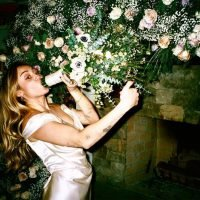 Miley Cyrus Pretends to Smoke Her Floral Bouquet in Playful Wedding Photos