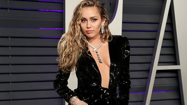 Miley Cyrus Stuns In Black Sequined Low-Cut Gown At Vanity Fair's Oscars Party — Pics