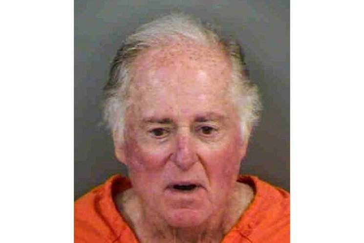 Sportscaster Warner Wolf Arrested for Allegedly Removing a Sign with Racist Connotations