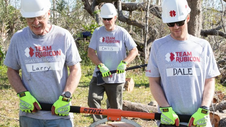 Dale Earnhardt Jr. gets dirty with Team Rubicon during hurricane clean-up efforts in Florida