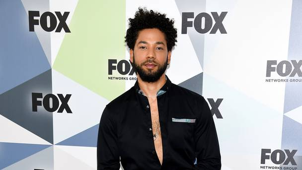 Empire actor Jussie Smollett turns himself in to face charge after allegedly lying to police