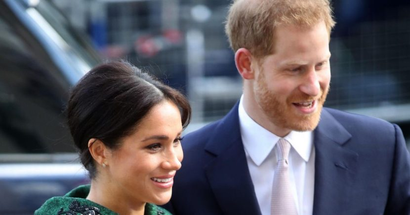 Heavily-pregnant Meghan Markle steps out in towering heels for event with Harry