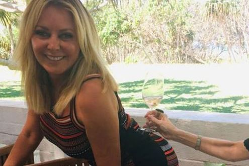 Carol Vorderman, 58, balances a glass of wine on her bum as she recreates Kim Kardashian's Paper magazine shoot