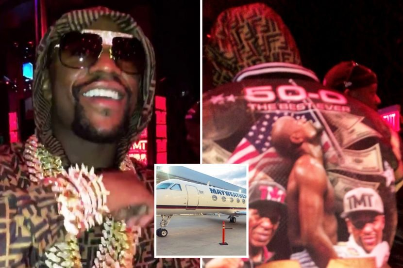 Mayweather dances with strippers on podium after taking private jet to his own Las Vegas strip club