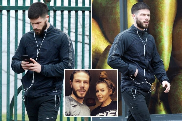 Stacey Dooley's ex boyfriend Sam Tucknott looks down as he's spotted for the first time since split with Strictly star