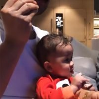 John Legend and His Mini-Me Baby Miles Chow Down on Ribs While Watching Family Feud
