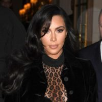 Kim Kardashian Goes Braless In Totally Sheer Leopard Bodysuit in Paris – See Pics