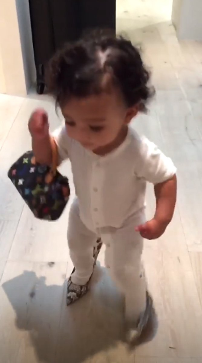Watch Kim Kardashian's Daughter Chicago Adorably Run Off with Her Mom's Designer Bags