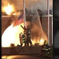 Virginia firefighters save American flag as fire destroys building in viral video