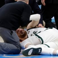 GRAPHIC VIDEO: Michigan State's Kyle Ahrens lands awkwardly on ankle, taken off court