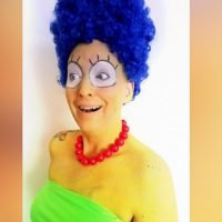 Woman smiles through cancer treatments by dressing as iconic characters