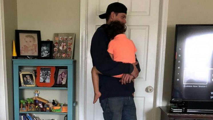 This cable tech working while holding a fussy child is all you need today