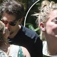 Amber Heard plants a kiss on her new beau Andy Muschietti