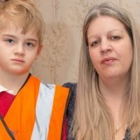 Mum of boy 'made to wear bib so teachers know he's autistic' takes legal action