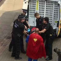 Moment 'Man of Steel' dressed as Superman steps in to help police nab rowdy drunk