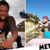 Man cycles around the world with a stray cat by his side