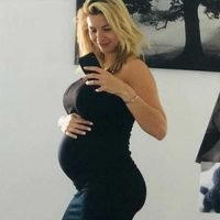 Pregnant Gemma Atkinson shows off her growing baby bump in clinging black dress as she jokes she looks like an Easter Egg