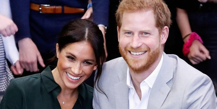 Meghan Markle's Latest Maternity Style Hack Is Wearing Prince Harry's Clothes