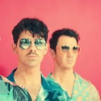 The Jonas Brothers drop Cool music video with '80s beach party vibe